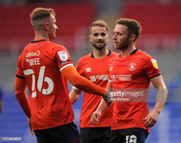 Jordan Clark of Luton Town celebrates with James Bree of Luton Town after scoring his team's first goal during Carabao Cup Second Round match between...