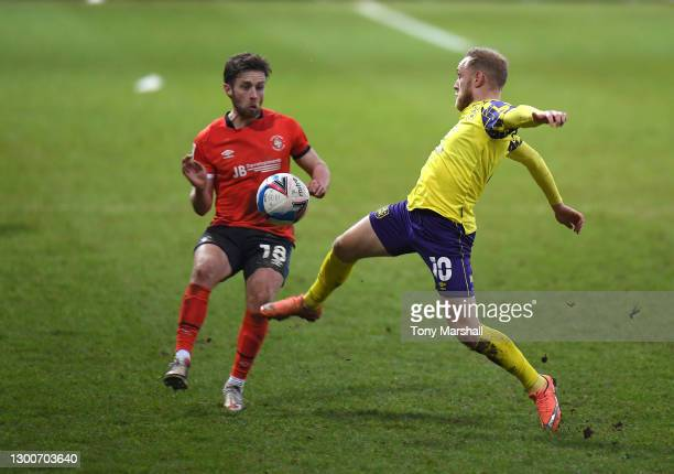 Jordan Clark of Luton Town challenges Alex Pritchard of Huddersfield Town during the Sky Bet Championship match between Luton Town and Huddersfield...