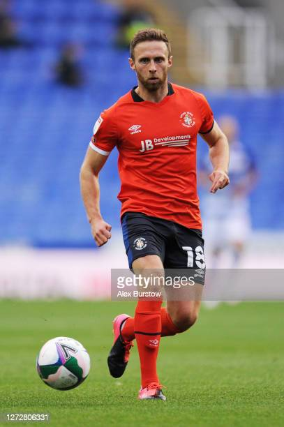 Jordan Clark of Luton Town passes the ball during the Carabao Cup Second Round match between Reading and Luton Town at Madejski Stadium on September...