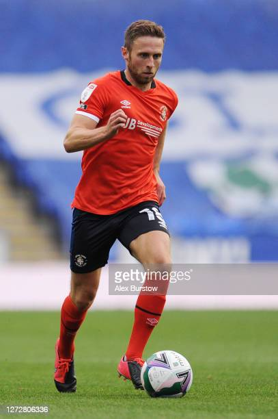 Jordan Clark of Luton Town runs with the ball during the Carabao Cup Second Round match between Reading and Luton Town at Madejski Stadium on...