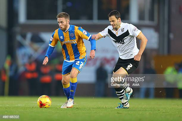 Jordan Clark of Shrewsbury Town and Ben Purkiss of Port Vale during the Sky Bet League One match between Port Vale and Shrewsbury Town at Vale Park...