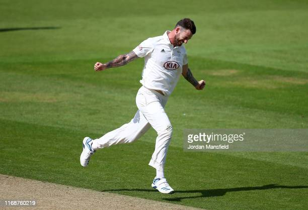 Jordan Clark of Surrey celebrates dismissing Felix Organ of Hampshire during Day One of the Specsavers County Championship Division 1 match between...