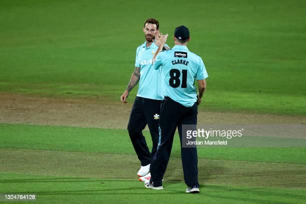 Jordan Clark of Surrey celebrates with Rikki Clarke of Surrey after dismissing Dan Lawrence of Essex Eagles during the Vitality T20 Blast match...