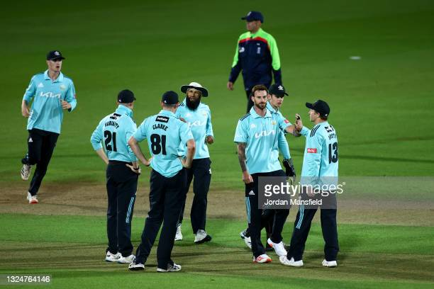 Jordan Clark of Surrey celebrates with with his teammates after dismissing Dan Lawrence of Essex Eagles during the Vitality T20 Blast match between...