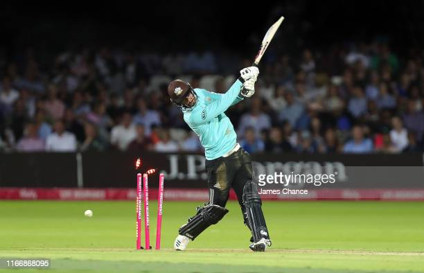 Jordan Clark of Surrey is bowled by Toby Roland-Jones of Middlesex during the Vitality T20 Blast match between Middlesex and Surrey at Lord's Cricket...