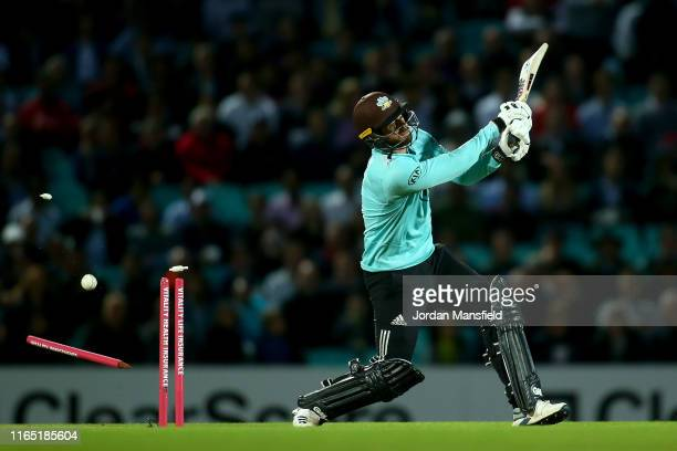 Jordan Clark of Surrey is bowled out by Hardus Viljoen of Kent during the Vitality Blast match between Surrey and Kent Spitfires at The Kia Oval on...