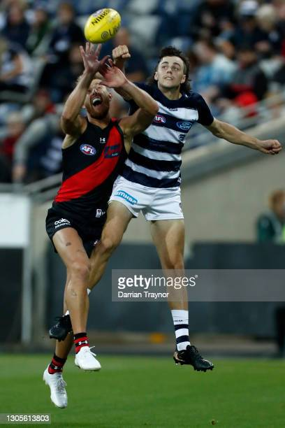 Jordan Clark of the Cats spoils Dyson Heppell of the Bombers during the AFL Community Series match between the Geelong Cats and the Essendon Bombers...