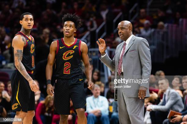Jordan Clarkson and Collin Sexton listen to Larry Drew of the Cleveland Cavaliers during the first half against the Houston Rockets at Quicken Loans...