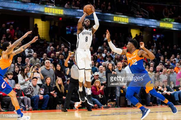 Jordan Clarkson and David Nwaba of the Cleveland Cavaliers try to block DeMarre Carroll of the Brooklyn Nets as he hits a buzzer beater shot to send...