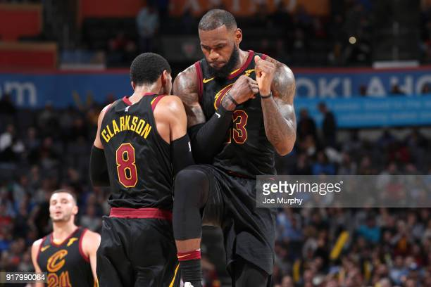 Jordan Clarkson and LeBron James of the Cleveland Cavaliers celebrate during the game against the Oklahoma City Thunder on February 13 2018 at...