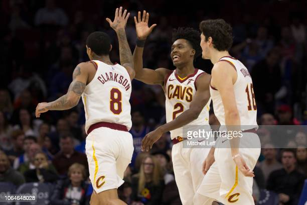 Jordan Clarkson Collin Sexton and Cedi Osman of the Cleveland Cavaliers celebrate during a timeout in the fourth quarter against the Philadelphia...
