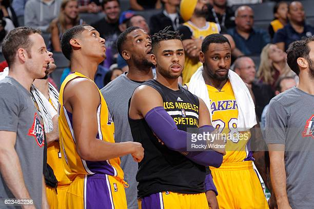 Jordan Clarkson D'Angelo Russell and Tarik Black of the Los Angeles Lakers look on during the game against the Sacramento Kings on November 10 2016...