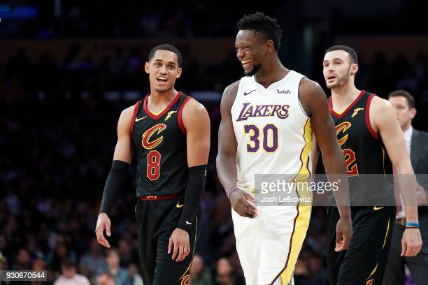 Jordan Clarkson of the Cleveland Cavaliers and Julius Randle of the Los Angeles Lakers laugh in between quarters the at Staples Center on March 11...