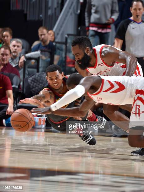 Jordan Clarkson of the Cleveland Cavaliers dives for the loose ball against James Harden of the Houston Rockets on November 24 2018 at Quicken Loans...