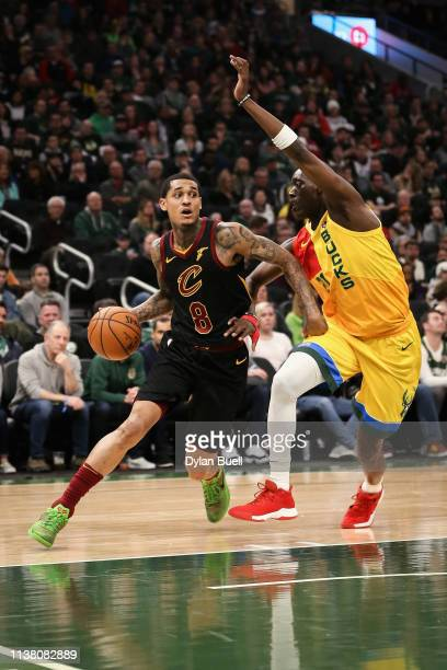 Jordan Clarkson of the Cleveland Cavaliers dribbles the ball while being guarded by Tony Snell of the Milwaukee Bucks in the second quarter at the...