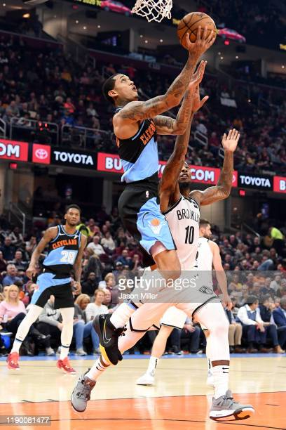 Jordan Clarkson of the Cleveland Cavaliers shoots over Iman Shumpert of the Brooklyn Nets during the first half at Rocket Mortgage Fieldhouse on...
