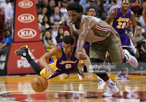 Jordan Clarkson of the Los Angeles Lakers and Justise Winslow of the Miami Heat fight for a loose ball during a game at American Airlines Arena on...