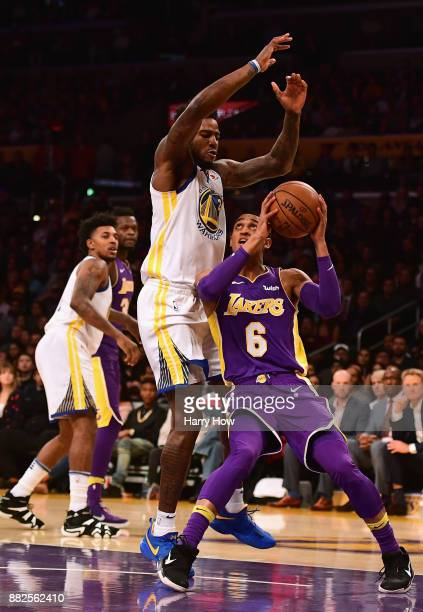 Jordan Clarkson of the Los Angeles Lakers attempts a shot under Jordan Bell of the Golden State Warriors during a 127123 Warriors overtime win at...