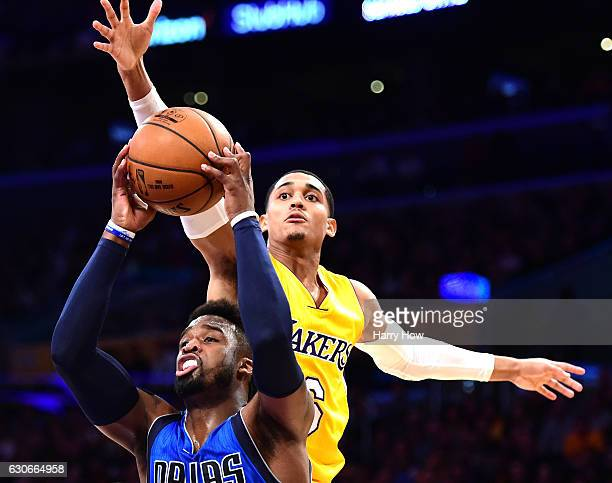 Jordan Clarkson of the Los Angeles Lakers attempts to block the shot of Wesley Matthews of the Dallas Mavericks during the first half at Staples...
