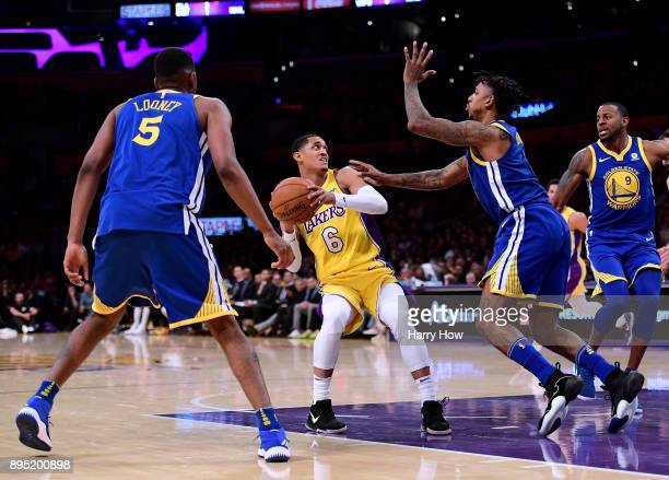 Jordan Clarkson of the Los Angeles Lakers attempts to drive on Nick Young Kevon Looney and Andre Iguodala of the Golden State Warriors of the Golden...