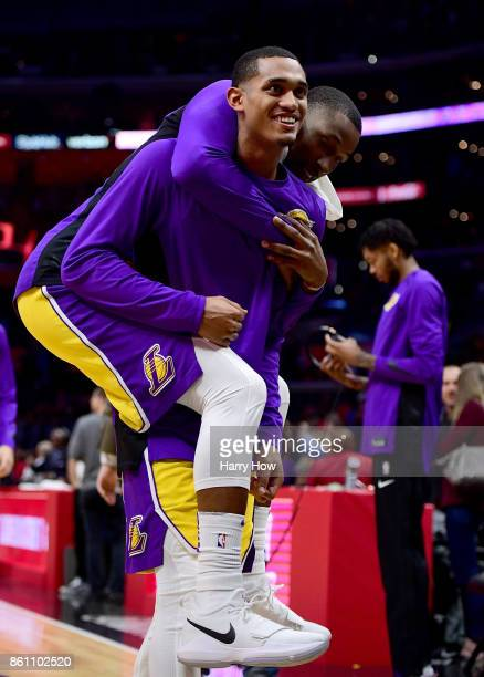 Jordan Clarkson of the Los Angeles Lakers carries off Kentavious CaldwellPope after a 111104 win over the LA Clippers at Staples Center on October 10...