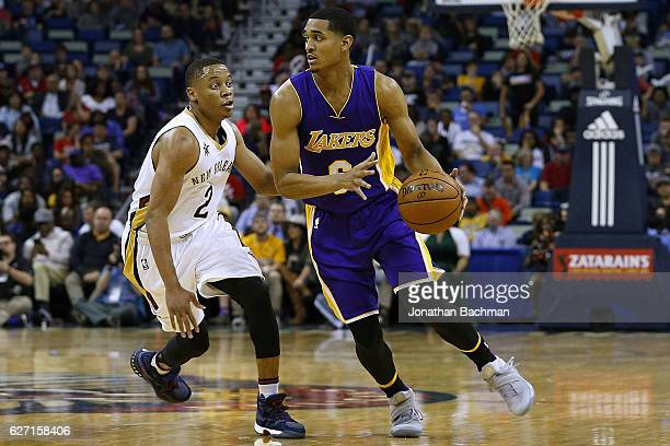 597734cb798469 Jordan Clarkson of the Los Angeles Lakers drives against Tim Frazier of the  New Orleans Pelicans