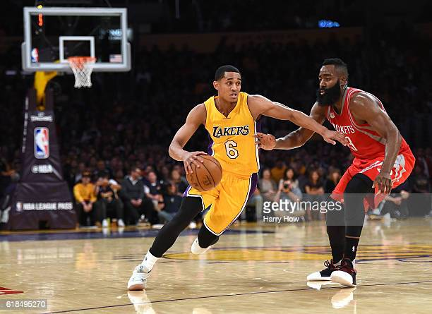 Jordan Clarkson of the Los Angeles Lakers drives on James Harden of the Houston Rockets during a 120114 season opening Laker win at Staples Center on...