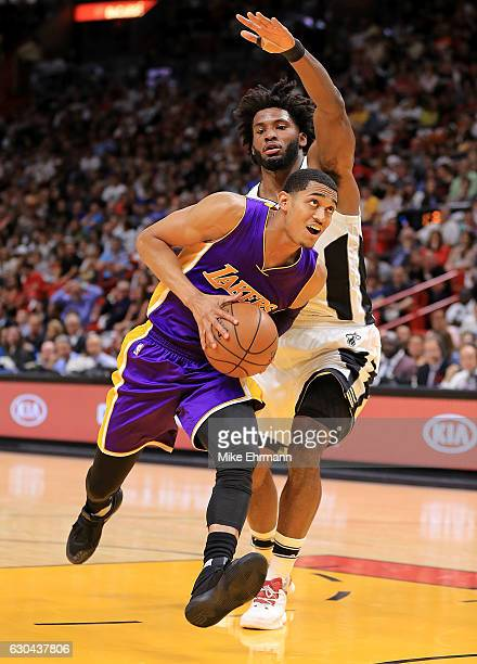 Jordan Clarkson of the Los Angeles Lakers drives on Justise Winslow of the Miami Heat during a game at American Airlines Arena on December 22 2016 in...