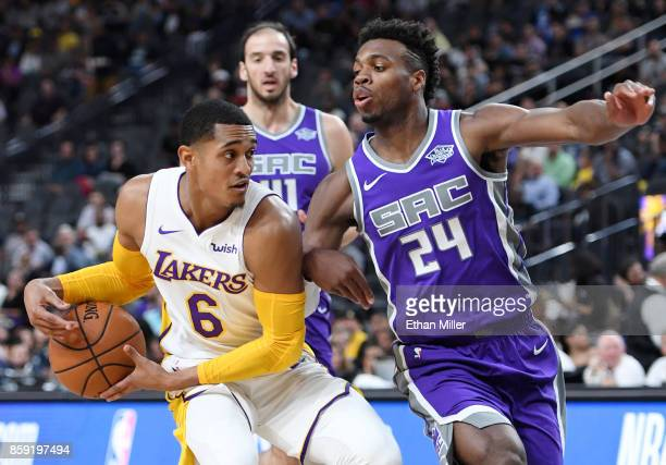 Jordan Clarkson of the Los Angeles Lakers drives to the basket against Buddy Hield of the Sacramento Kings during their preseason game at TMobile...