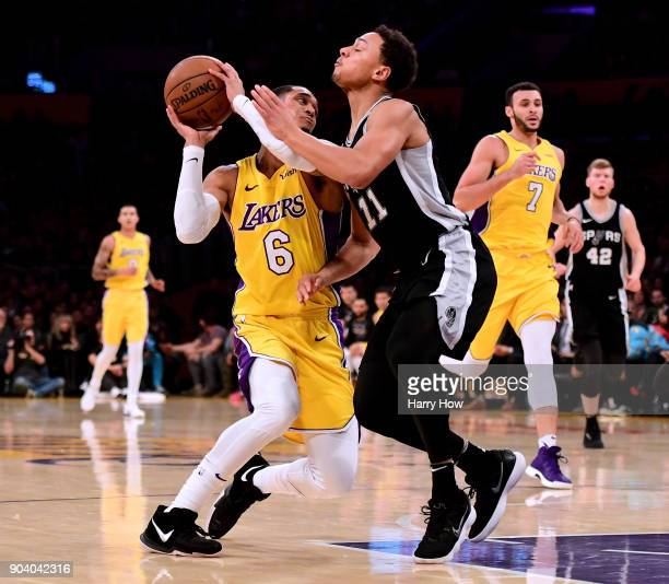 Jordan Clarkson of the Los Angeles Lakers drives to the basket on Bryn Forbes of the San Antonio Spurs during the first half at Staples Center on...