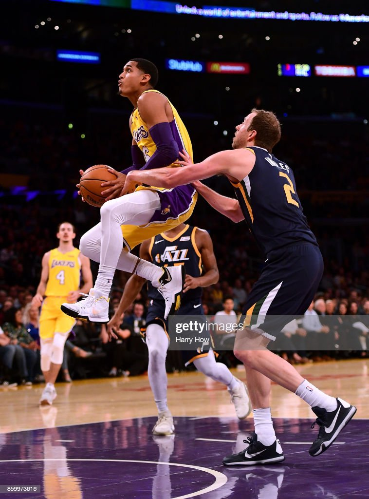 Jordan Clarkson #6 of the Los Angeles Lakers gets fouled by Joe Ingles #2 of the Utah Jazz as he jumps to the basket during the first half at Staples Center on October 10, 2017 in Los Angeles, California.