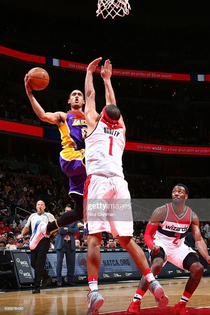 Jordan Clarkson #6 of the Los Angeles Lakers goes for the layup against Jared Dudley #1 of the Washington Wizards during the game on December 2, 2015 at Verizon Center in Washington, DC.