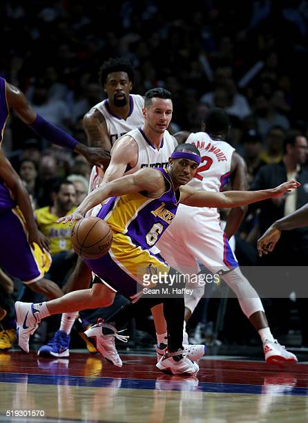 Jordan Clarkson of the Los Angeles Lakers has the ball stripped by JJ Redick of the Los Angeles Clippers during the second half of an NBA game...