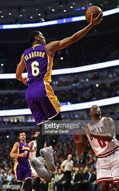 Jordan Clarkson of the Los Angeles Lakers puts up a shot over Isaiah Canaan of the Chicago Bulls at the United Center on November 30 2016 in Chicago...
