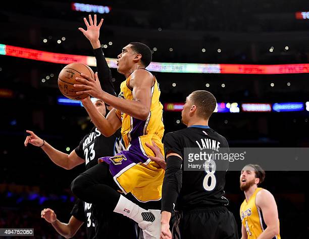 Jordan Clarkson of the Los Angeles Lakers scores on a layup between Kevin Martin and Zach LaVine of the Minnesota Timberwolves during the first...