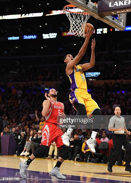 Jordan Clarkson of the Los Angeles Lakers scores on his layup as he is fouled by Tyler Ennis of the Houston Rockets during a 120114 season opening...