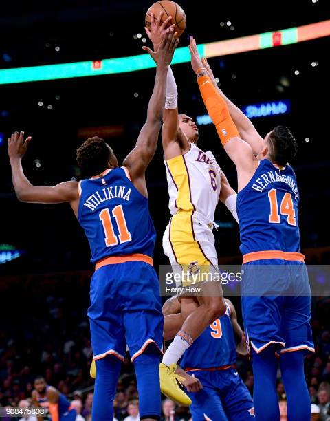 Jordan Clarkson of the Los Angeles Lakers scores over Frank Ntilikina and Willy Hernangomez of the New York Knicks during a 127107 Laker win at...
