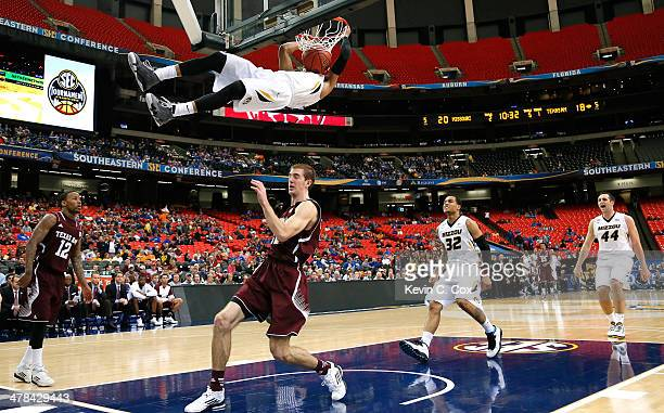 Jordan Clarkson of the Missouri Tigers dunks against Alex Caruso of the Texas AM Aggies during the second round of the SEC Men's Basketball...