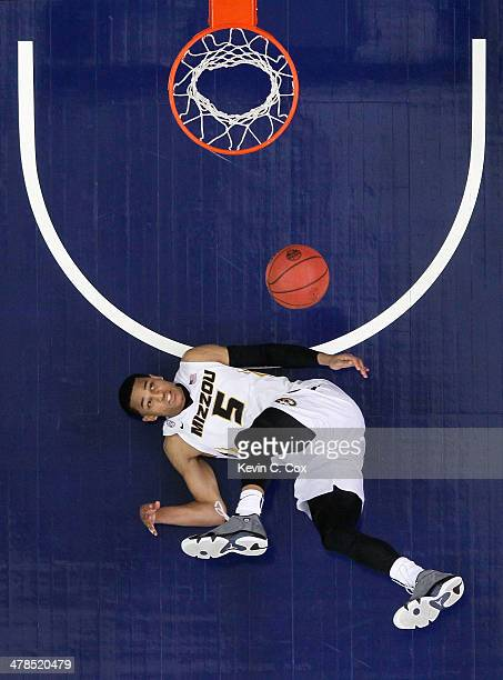 Jordan Clarkson of the Missouri Tigers falls to the floor as he watches his shot against the Texas AM Aggies during the second round of the SEC Men's...
