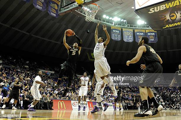 Jordan Clarkson of the Missouri Tigers is guarded by Jordan Mickey of the LSU Tigers during a game at the Pete Maravich Assembly Center on January 21...