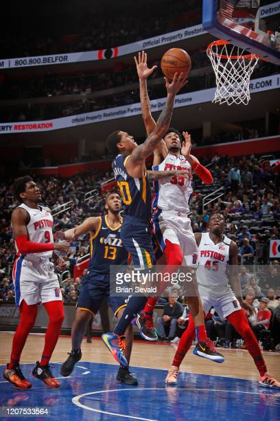 Jordan Clarkson of the Utah Jazz drives to the basket while Christian Wood of the Detroit Pistons plays defense on March 7 2020 at Little Caesars...