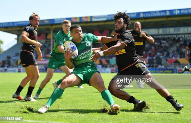 Jordan Conroy of Ireland is tackled by Ben Ellermann of Germany during the Cup Quarter Final match between Ireland and Germany on day two of the Mens...