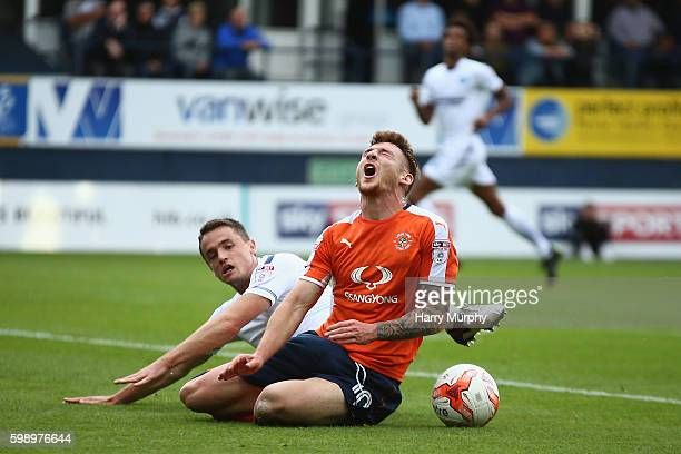 Jordan Cook of Luton is brought down by Stephen McGinn of Wycombe to win a penalty during the Sky Bet League Two match between Luton Town and Wycombe...
