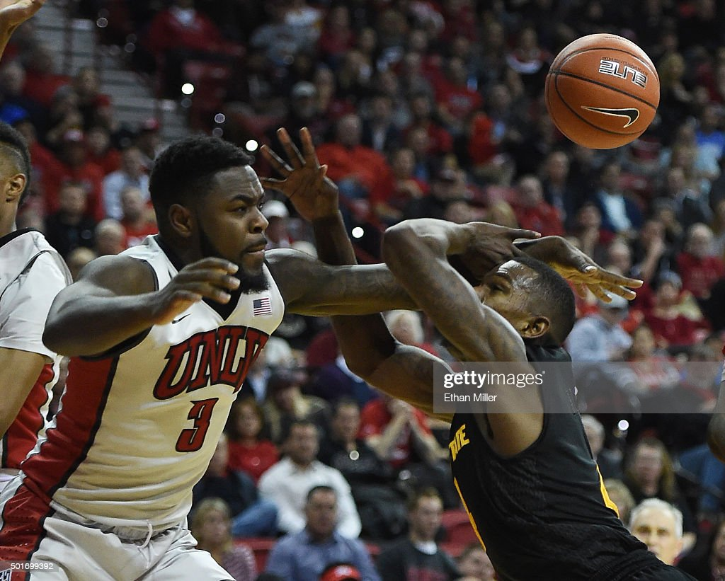 Jordan Cornish #3 of the UNLV Rebels fouls Gerry Blakes #4 of the Arizona State Sun Devils during their game at the Thomas & Mack Center on December 16, 2015 in Las Vegas, Nevada. Arizona State won 66-56.