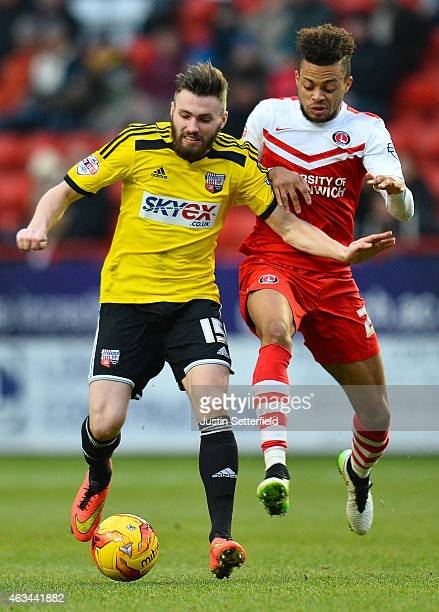 Jordan Cousins of Charlton Athletic and Stuart Dallas of Brentford FC during the Sky Bet Championship match between Charlton Athletic and Brentford...