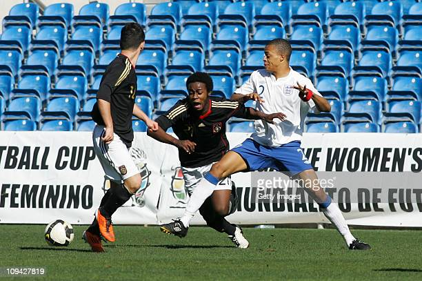 Jordan Cousins of U17 England challenges Erich Berko of U17 Germany during the international friendly match between U17 England and U17 Germany at...