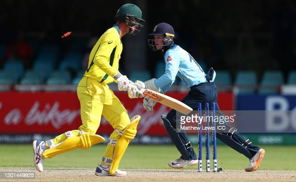 Jordan Cox of England stumps Lachlan Hearne of Australia during the ICC U19 Cricket World Cup Group B match between Australia and England at De Beers...