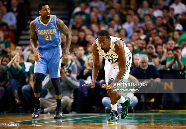 Jordan Crawford of the Boston Celtics celebrates following a made basket in the second half against the Denver Nuggets during the game at TD Garden...