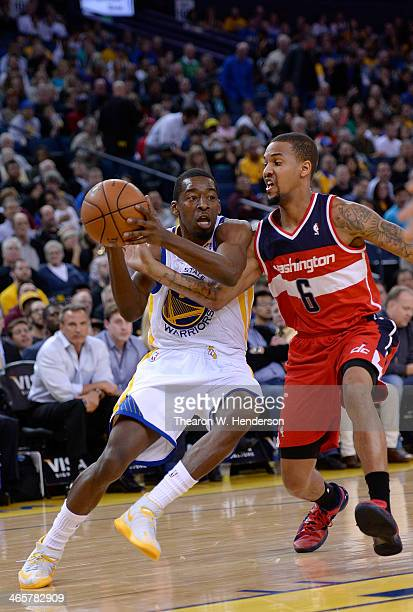 Jordan Crawford of the Golden State Warriors drives and gets fouled by Eric Maynor of the Washington Wizards at ORACLE Arena on January 28 2014 in...