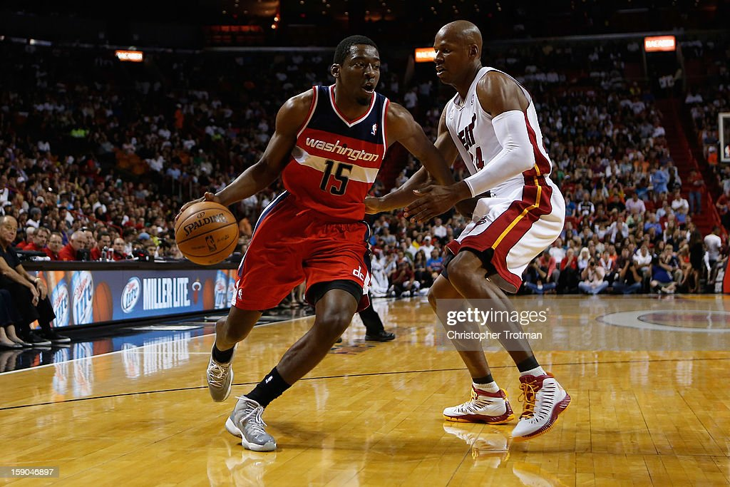 Jordan Crawford #15 of the Washington Wizards drives against (R) Ray Allen #34 of the Miami Heat at American Airlines Arena on January 6, 2013 in Miami, Florida.